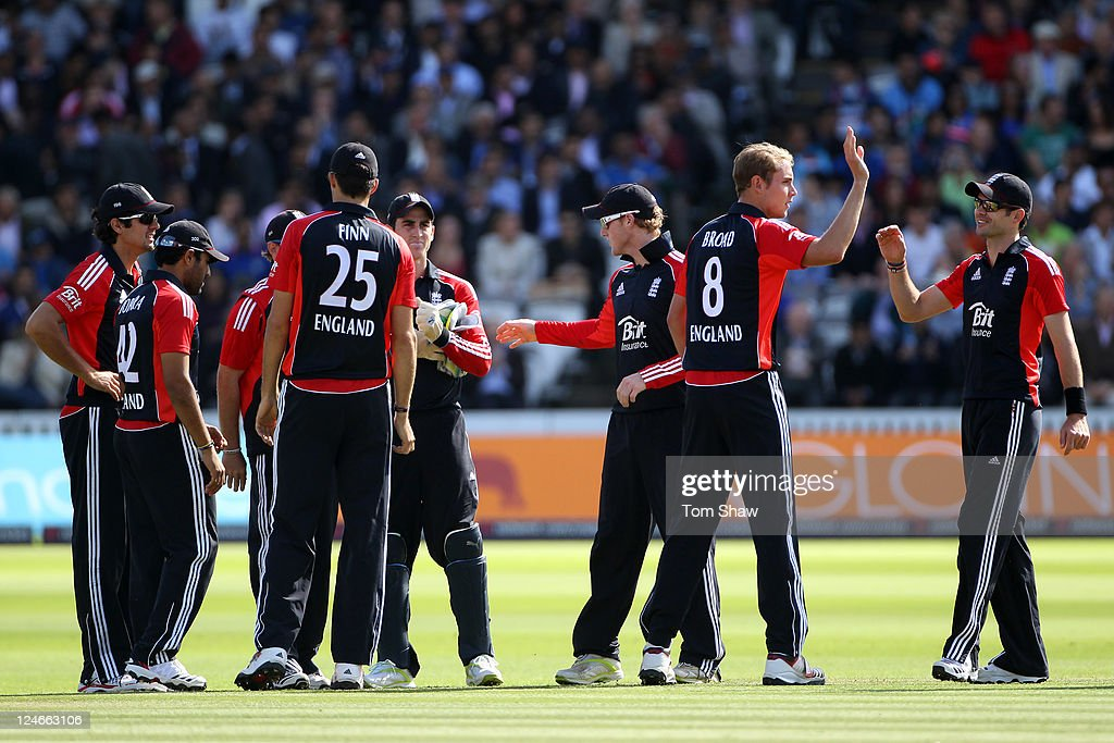 Stuart Broad (2nd R) of England celebrates with his team mates after trapping Rajinkya Rahane of India lbw during the 4th Natwest One Day International match between England and India at Lord's Cricket Ground on September 11, 2011 in London, United Kingdom.