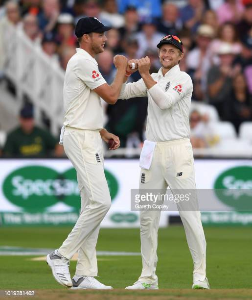 Stuart Broad of England celebrates with Joe Root after catching out Mohammed Shami of India during day two of the Specsavers 3rd Test match between...