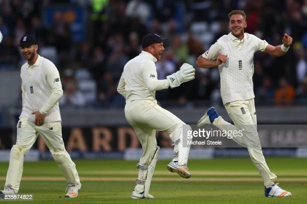 Stuart Broad of England celebrates with Jonny Bairstow after capturing the wicket of Jason Holder during day three of the 1st Investec Test match...