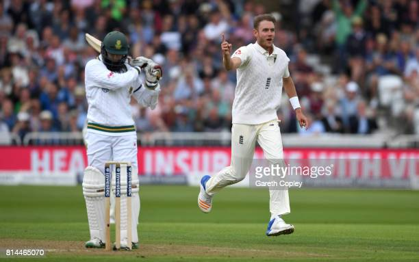 Stuart Broad of England celebrates with Moeen Ali after dismissing Hashim Amla of South Africa during day one of the 2nd Investec Test match between...