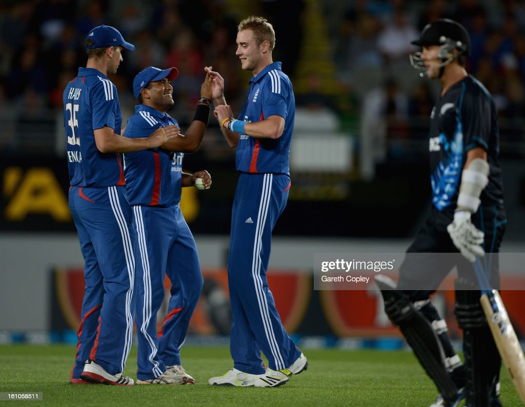 Stuart Broad of England celebrates with Samit Patel and Alex Hales after dismissing Trent Boult of New Zealand during the 1st T20 International between New Zealand and England at Eden Park on February 9, 2013 in Auckland, New Zealand.