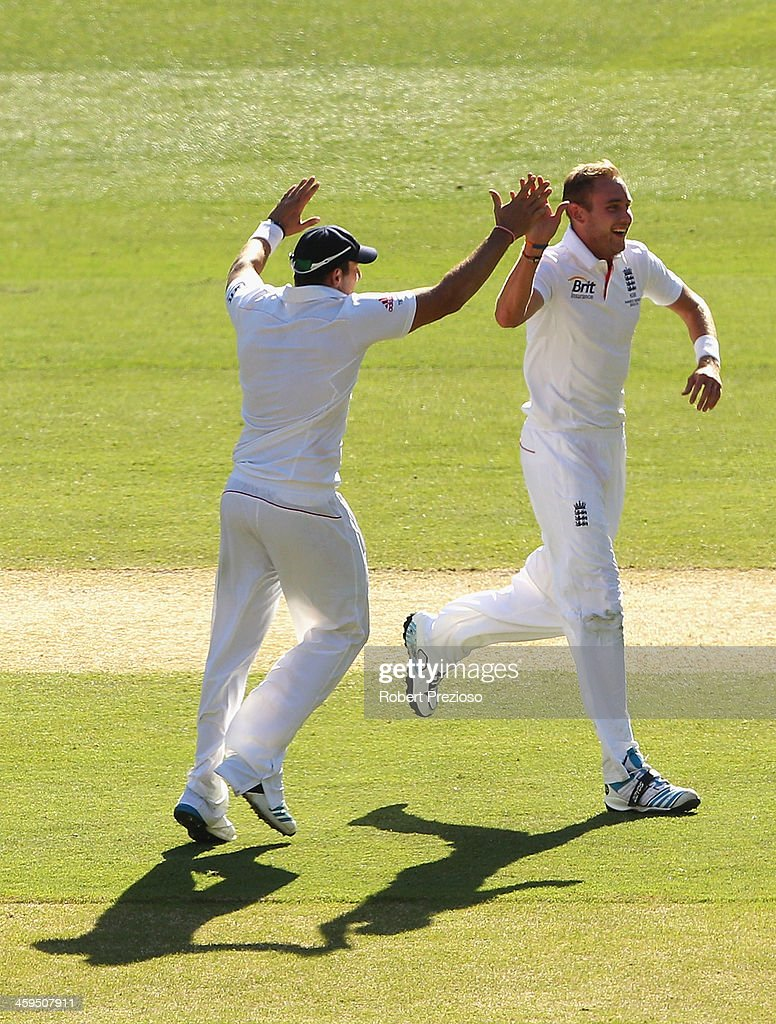 Stuart Broad of England celebrates with team mates after taking the wicket of Ryan Harris of Australia during day two of the Fourth Ashes Test Match between Australia and England at Melbourne Cricket Ground on December 27, 2013 in Melbourne, Australia.