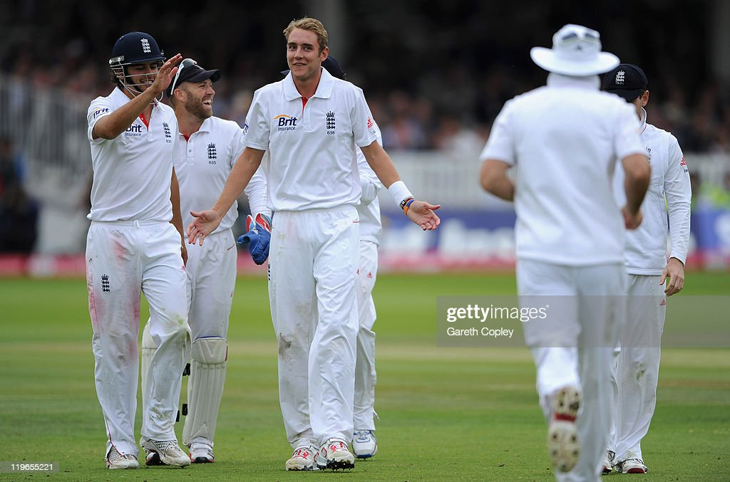 Stuart Broad (C) of England celebrates with teamates after dismissing Praveen Kumar of Indian during the first npower test match between England v India at Lord's Cricket Ground on July 23, 2011 in London, England.