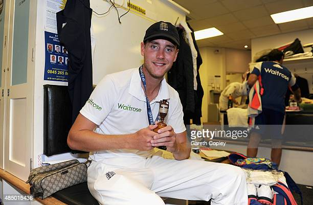 Stuart Broad of England celebrates with the ashes urn in the dressing rooms after the 5th Investec Ashes Test match between England and Australia at...