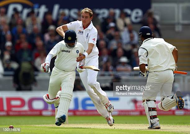 Stuart Broad of England colides with Amit Mishra of India during day one of the 3rd npower Test at Edgbaston on August 10 2011 in Birmingham England