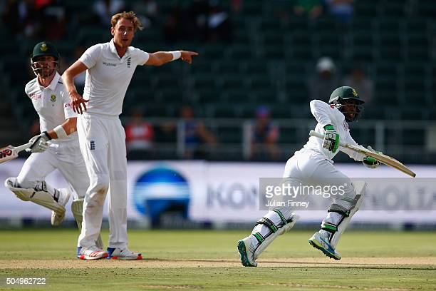 Stuart Broad of England directs the throw as Temba Bavuma of South Africa fails to make his ground after Chris Woakes's fields to Jonny Bairstow of...