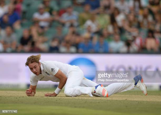 Stuart Broad of England dives to take a return catch off South Africa's Faf du Plessis to finish with 6 wickets for 17 runs as South Africa are...