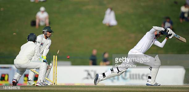 Stuart Broad of England is bowled by Abdur Rehman of Pakistan during the second Test match between Pakistan and England at Sheikh Zayed Stadium on...