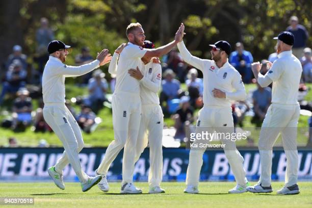 Stuart Broad of England is congratulated by team mates after claiming his 5th wicket during day three of the Second Test match between New Zealand...