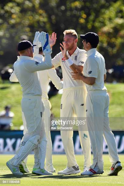 Stuart Broad of England is congratulated by team mates after dismissing Jeet Raval of New Zealand during day five of the Second Test match between...