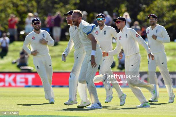 Stuart Broad of England is congratulated by team mates after dismissing Kane Williamson of New Zealand during day five of the Second Test match...