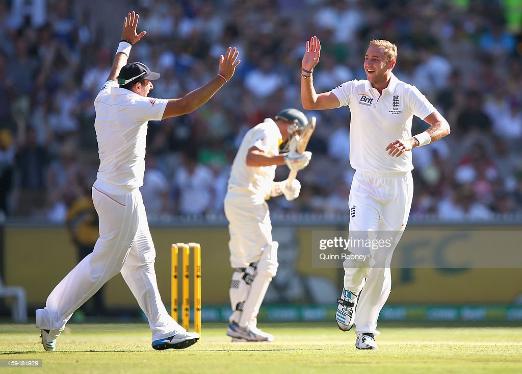 Stuart Broad of England is congratulated by Tim Bresnan after taking the wicket of Ryan Harris of Australia during day two of the Fourth Ashes Test Match between Australia and England at Melbourne Cricket Ground on December 27, 2013 in Melbourne, Australia.