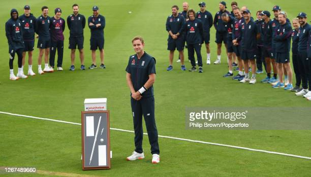 Stuart Broad of England is given an award for reaching 500 Test Match wickets before the first day of the Third Test match against Pakistan at the...