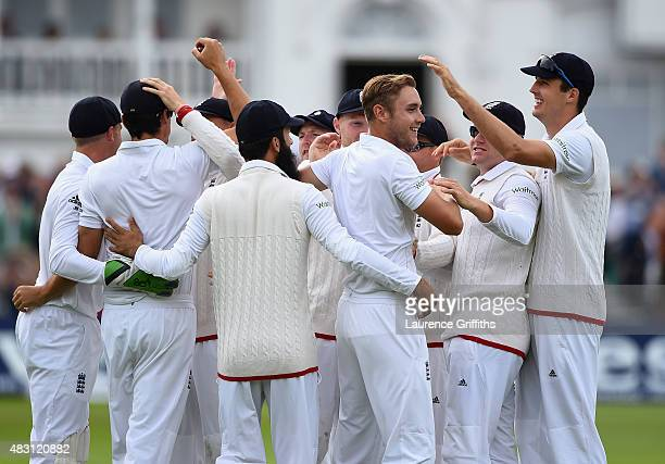 Stuart Broad of England is mobbed after taking the wicket of Chris Rogers of Australia during day one of the 4th Investec Ashes Test match between...