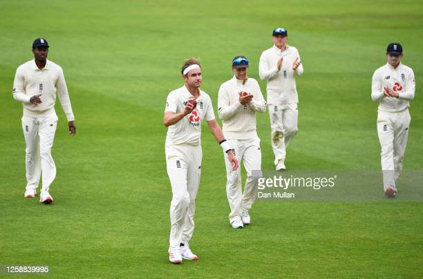 Stuart Broad of England leads his side off after taking six wickets during Day Three of the Ruth Strauss Foundation Test the Third Test in the...