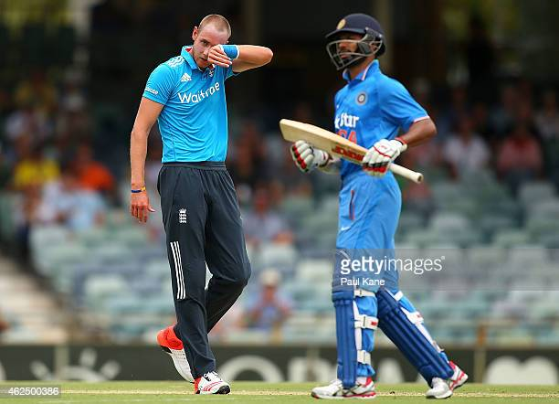 Stuart Broad of England looks on after being hit to the boundary by Shikhar Dhawan of India during the One Day International match between England...