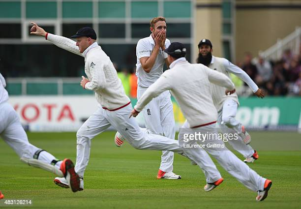 Stuart Broad of England looks on in disbelief at Ben Stokes after his amazing catch to dimiss Adam Voges of Australia during day one of the 4th...