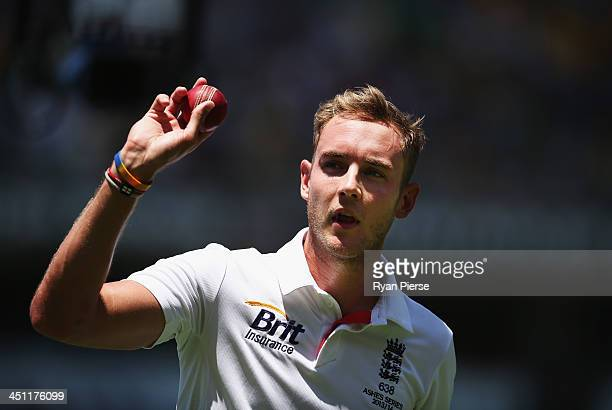 Stuart Broad of England raises the ball at the end of the innings after taking 6 wickets during day two of the First Ashes Test match between...