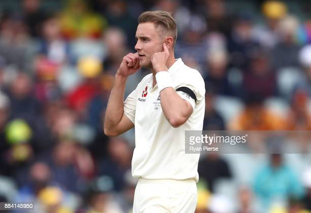 Stuart Broad of England signals to David Warner of Australia during day one of the Second Test match during the 2017/18 Ashes Series between...