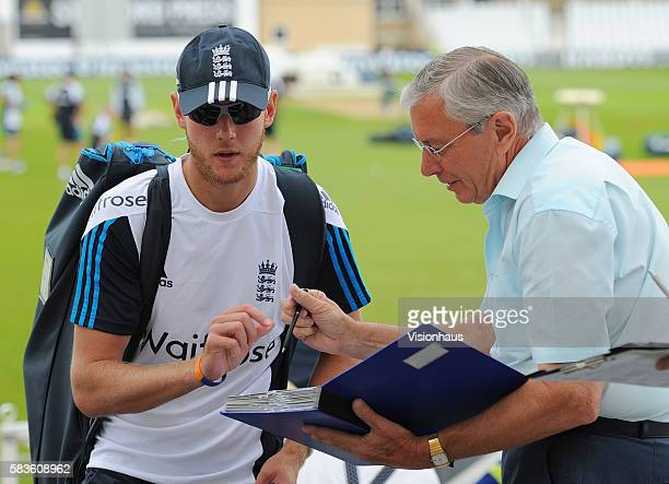 Stuart Broad of England signs autographs after net practice for the 1st Investec Test between England and India at Trent Bridge Cricket Ground in...