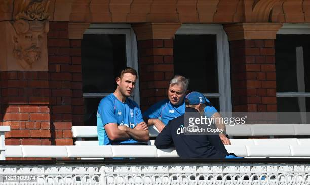 Stuart Broad of England speaks to coach Chris Silverwood and captain Joe Root a nets session at Lord's Cricket Ground on June 01, 2021 in London,...