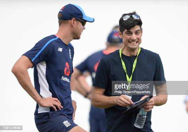 Stuart Broad of England speaks to Sir Alastair Cook before a training session at the Sir Vivian Richards Stadium before the second Test match between...