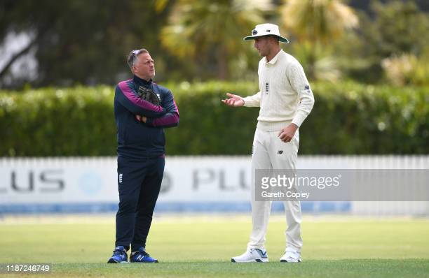 Stuart Broad of England speaks with coach Darren Gough during the tour match between New Zealand XI and England at Cobham Oval on November 13 2019 in...