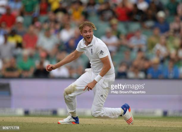 Stuart Broad of England starts to celebrate after catching South Africa's Faf du Plessis off his own bowling to finish with 6 wickets for 17 runs as...
