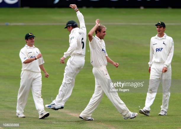 Stuart Broad of Nottinghamshire celebrates with team mate Graeme Swann after taking the wicket of Tim Ambrose during the LV County Championship match...