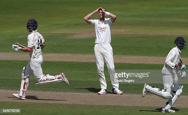 Stuart Broad of Nottinghamshire looks on as Tom Smith and Haseeb Hameed take a quick run during the Specsavers County Championship division one match...