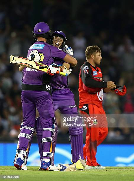Stuart Broad of the Hurricanes and Sam Rainbird of the Hurricanes celebrate after scoring a win during the Big Bash League match between the...