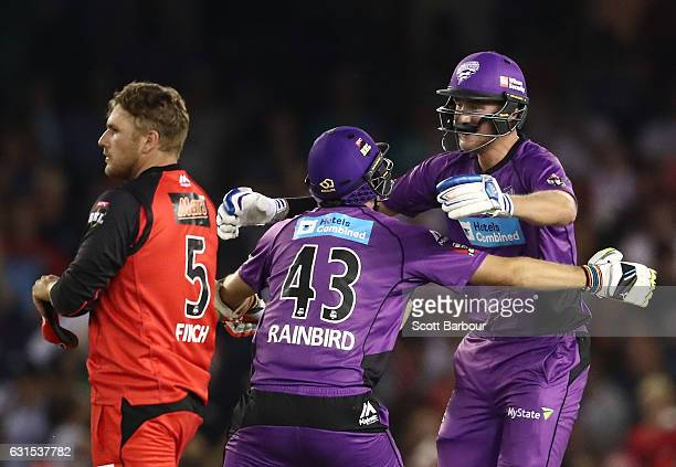 Stuart Broad of the Hurricanes is congratulated by Sam Rainbird after hitting the winning runs as Aaron Finch captain of the Renegades looks on...