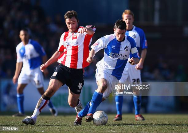 Stuart Campbell of Bristol Rovers battles with Marek Saganowski of Southampton during the FA Cup sponsored by Eon Fifth Round match between Bristol...