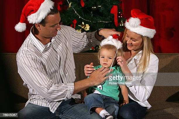 Stuart Clark and wife Michelle with son Lachlan pose during the Australian cricket team Christmas lunch at Crown Casino on December 25 2007 in...