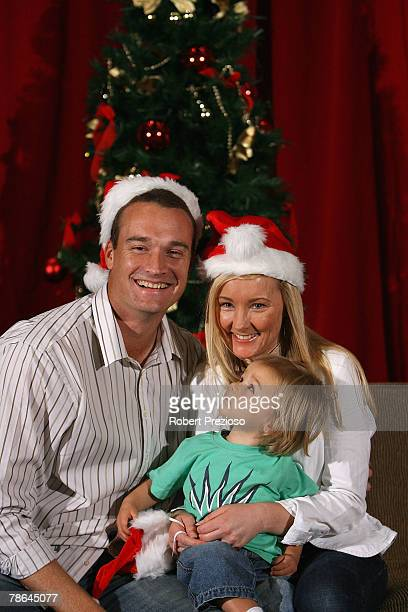 Stuart Clark and wife Michelle with son Lachlan pose for photos during the Australian cricket team Christmas lunch at Crown Casino on December 25...