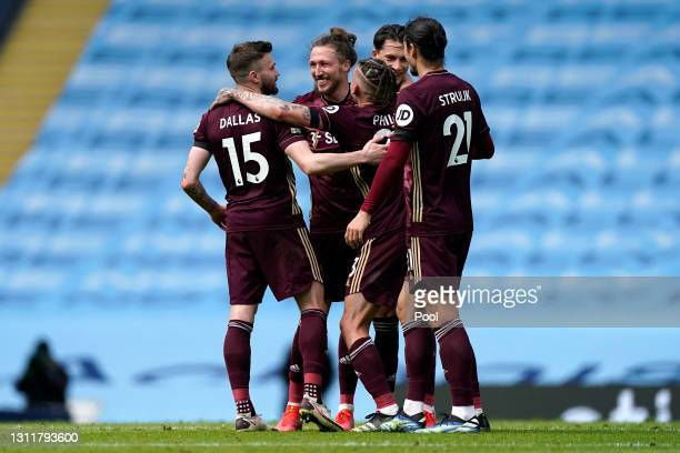 Stuart Dallas, Luke Ayling, Kalvin Phillips and Pascal Struijk of Leeds United celebrate after the Premier League match between Manchester City and...