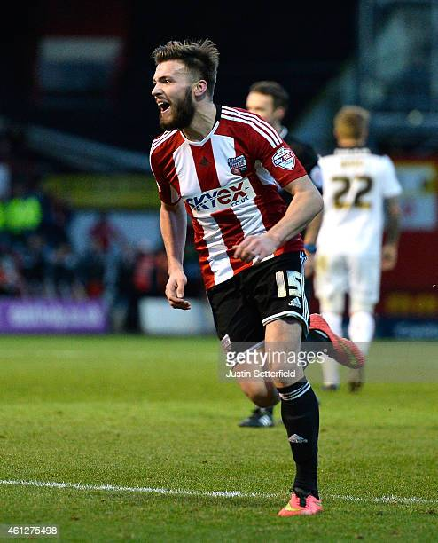 Stuart Dallas of Brentford FC celebrates scoring the first goal during the Sky Bet Championship match between Brentford and Rotherham United at...