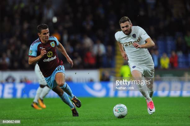 Stuart Dallas of Leeds and Ashley Westwood of Burnley in action during the Carabao Cup Third Round match between Burnley and Leeds United at Turf...