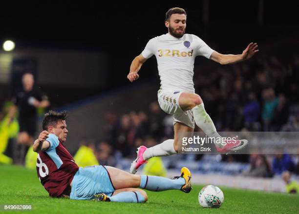 Stuart Dallas of Leeds and Kevin Long of Burnley in action during the Carabao Cup Third Round match between Burnley and Leeds United at Turf Moor on...