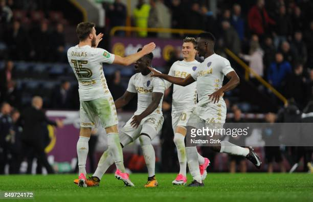 Stuart Dallas of Leeds celebrates with his team mates after scoring the winning penalty during the Carabao Cup Third Round match between Burnley and...