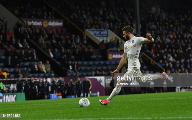 Stuart Dallas of Leeds scores the winning penalty during the Carabao Cup Third Round match between Burnley and Leeds United at Turf Moor on September...