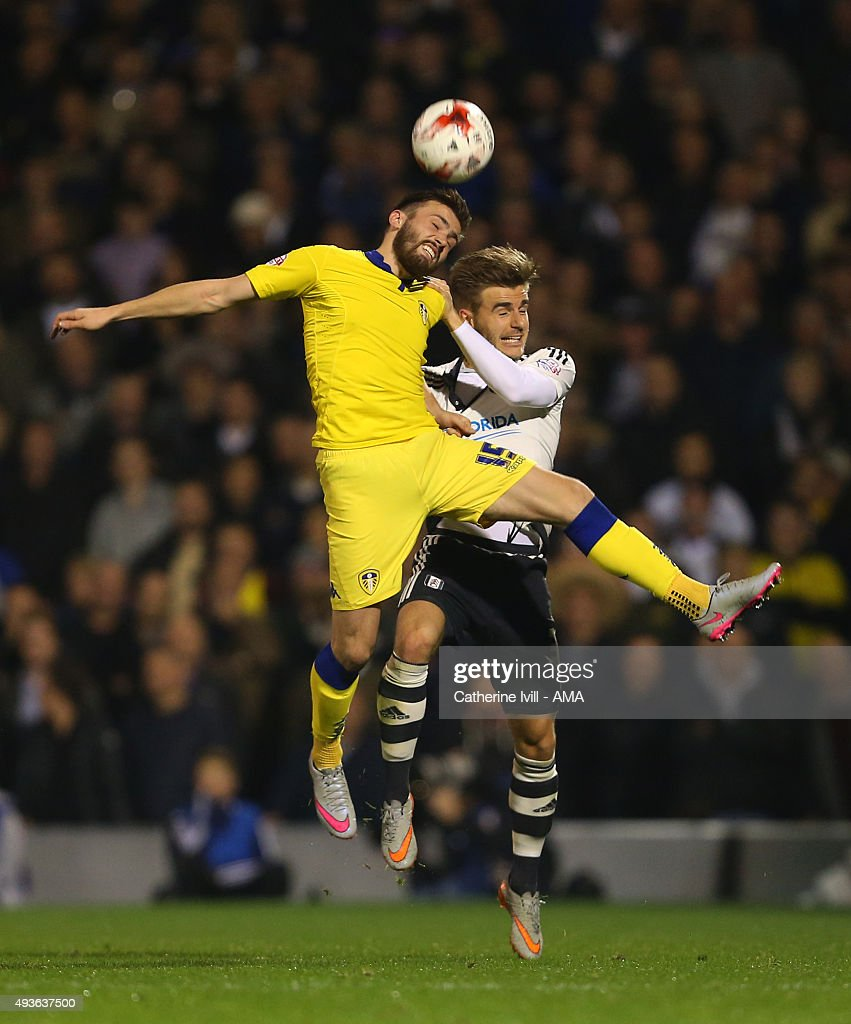 Stuart Dallas of Leeds United and Luke Garbutt of Fulham during the Sky Bet Championship match between Fulham and Leeds United at Craven Cottage on October 21, 2015 in London, England.