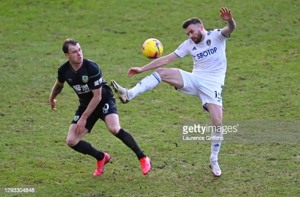 Stuart Dallas of Leeds United battles for possession with Ashley Barnes of Burnley during the Premier League match between Leeds United and Burnley...