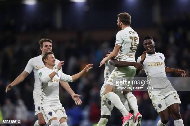 Stuart Dallas of Leeds United celebrates after scoring the winning penalty during the Carabao Cup Third Round match between Burnley and Leeds United...