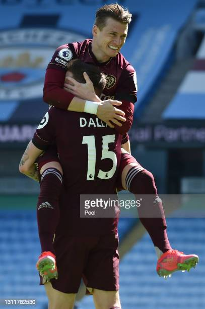 Stuart Dallas of Leeds United celebrates with EzgjanAlioski after scoring their team's first goal during the Premier League match between Manchester...