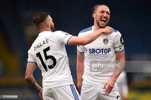 Stuart Dallas of Leeds United celebrates with Luke Ayling after scoring their side's first goal during the Premier League match between Leeds United...