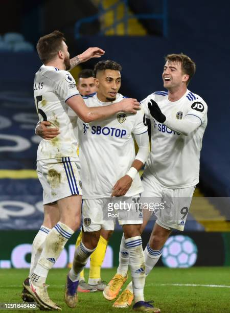 Stuart Dallas of Leeds United celebrates with teammates after scoring their team's third goal during the Premier League match between Leeds United...