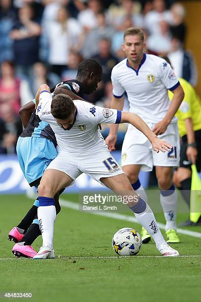 Stuart Dallas of Leeds United FC holds off Modou Sougou of Sheffield Wednesday FC during the Sky Bet Championship match between Leeds United and...