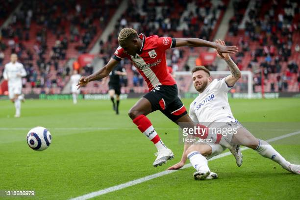 Stuart Dallas of Leeds United fouls Moussa Djenepo of Southampton and receives a booking during the Premier League match between Southampton and...