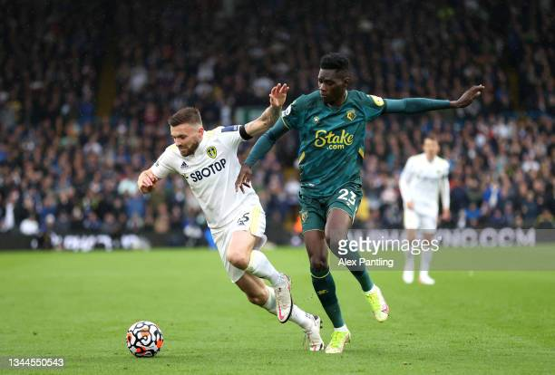 Stuart Dallas of Leeds United is challenged by Ismaila Sarr of Watford FC during the Premier League match between Leeds United and Watford at Elland...